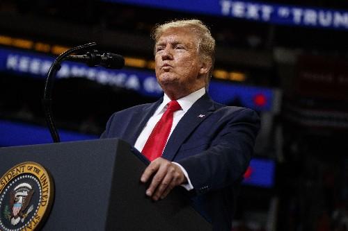 The Latest: Trump attacks trade deals in campaign kickoff