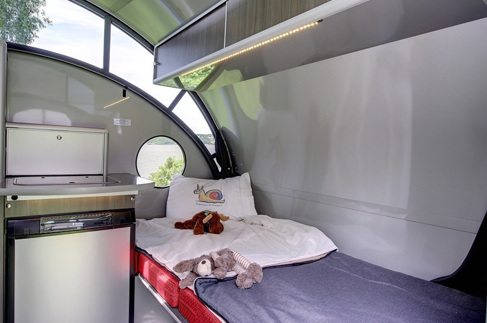 Safari Condo reinvents the teardrop with an electric pop-up roof
