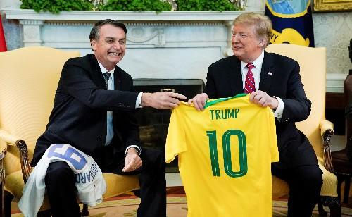 Trump endorses Bolsonaro at White House, mulls bringing Brazil into NATO