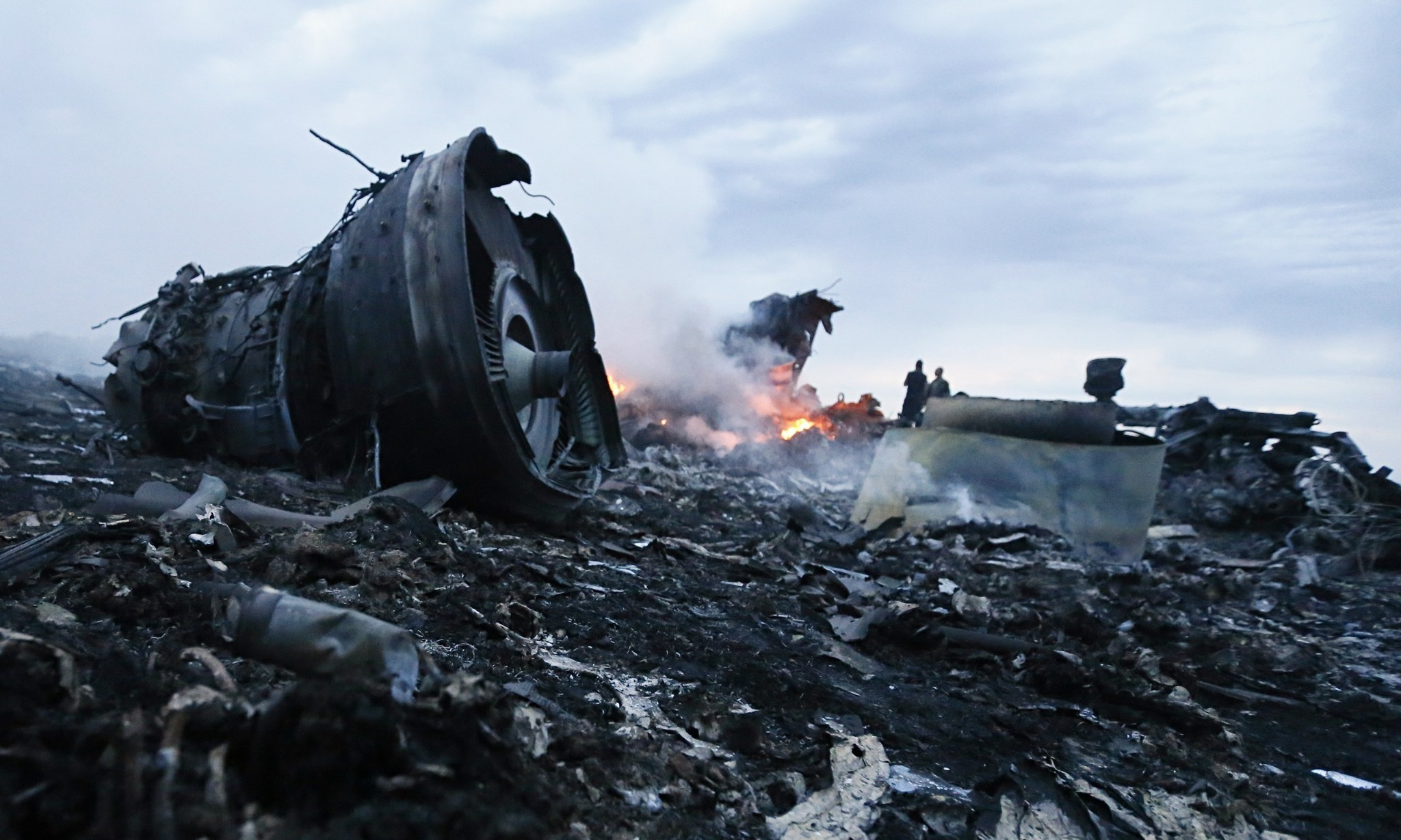 Sifting through the wreckage of MH17, searching for sense amid the horror