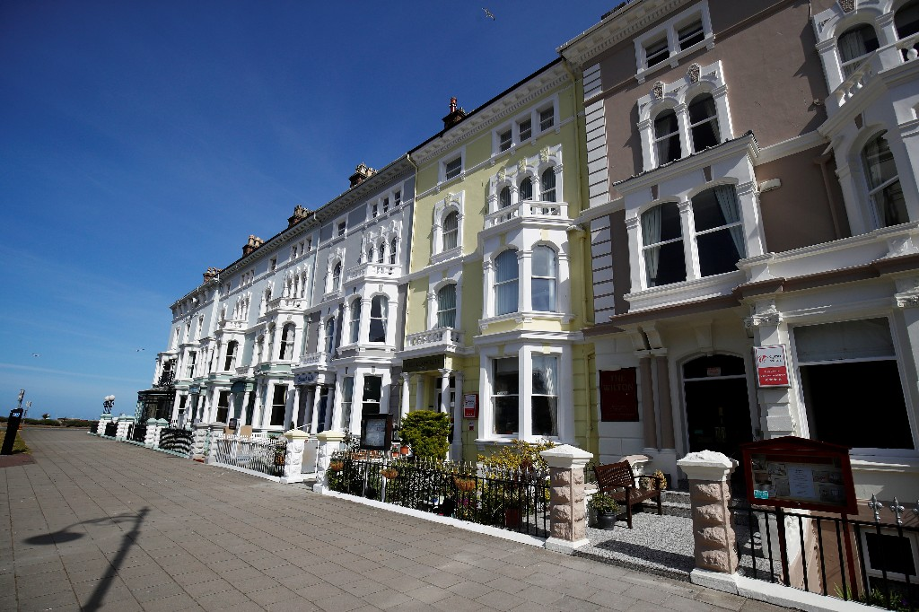 UK house prices fall for third month on COVID hit, Halifax says