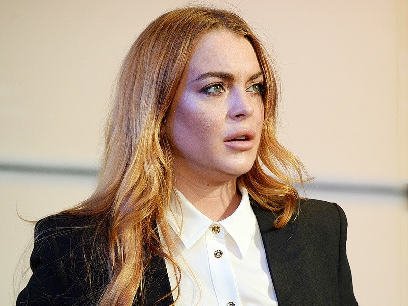 Lindsay Lohan Poses in Her Underwear and Jokes About Untreatable Illness