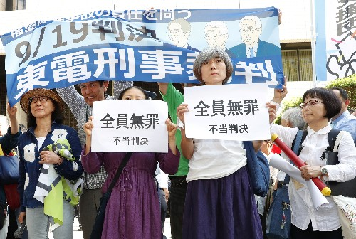 Tokyo court clears former Tepco executives of negligence over Fukushima disaster