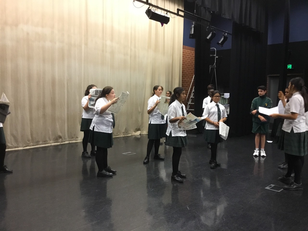 """Scene 1: """"The Market Place"""" being directed by the students."""