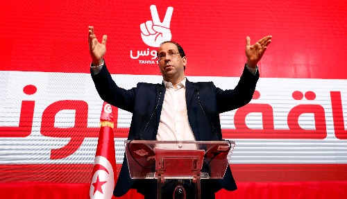 Tunisian PM Chahed enters crowded race in presidential vote