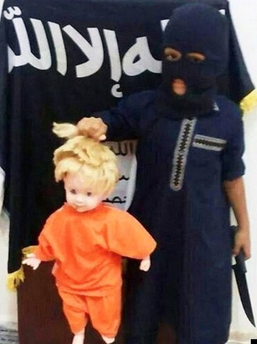 Islamic State Supporter Pictured Forcing Baby To Kick A Severed Head In Syria (GRAPHIC PICTURE)