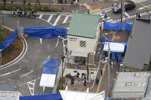 Japan arrests man for stabbing police officer, taking gun