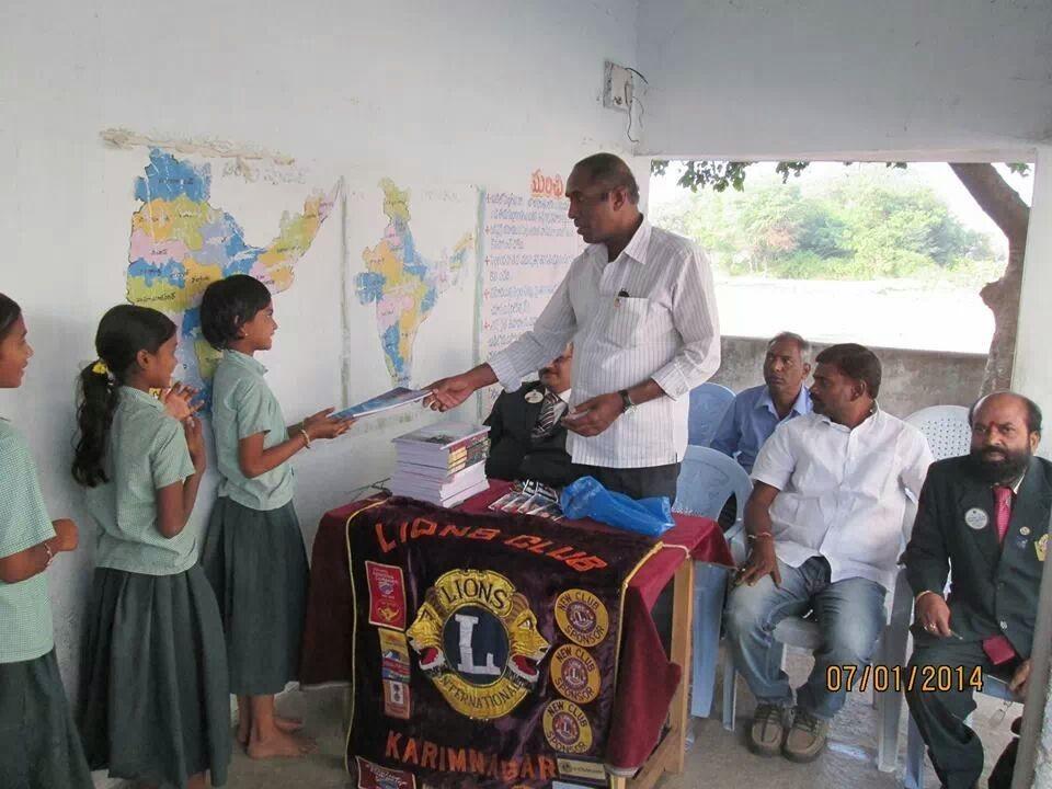 Distribution of note books and pen at govt school at errukulla village