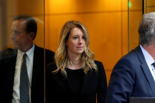 U.S. judge drops some charges against Theranos's Holmes, leaves wire fraud