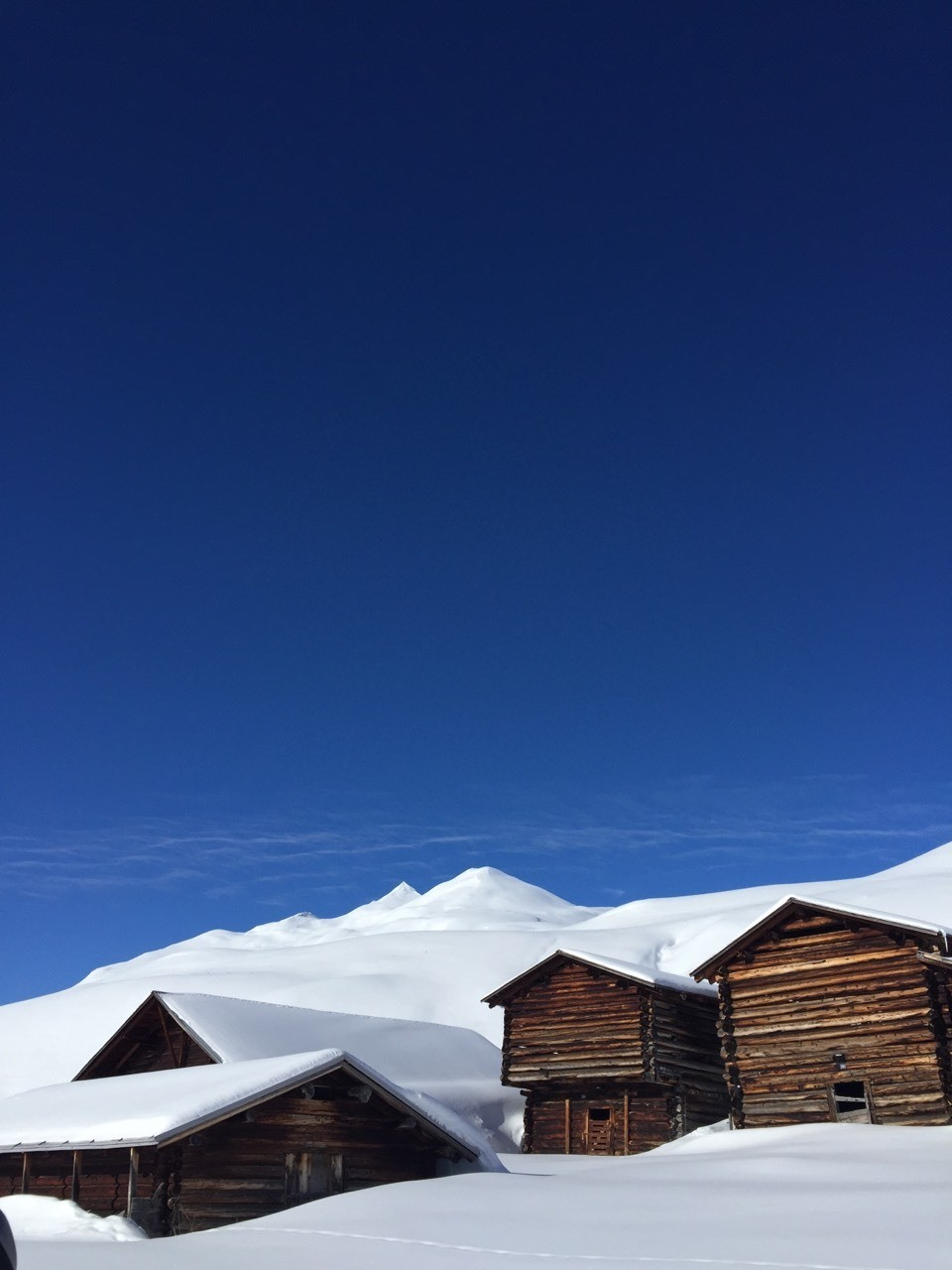 Swiss backcountry touring next to farmhouses.