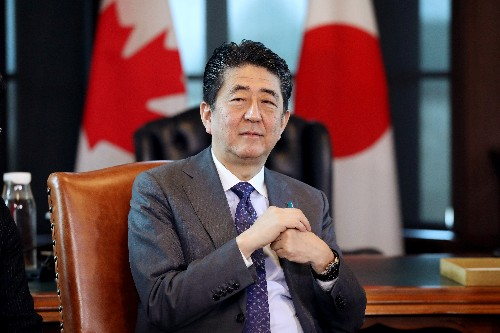 Japan's Abe signals shift on North Korea, says will meet Kim without conditions: media