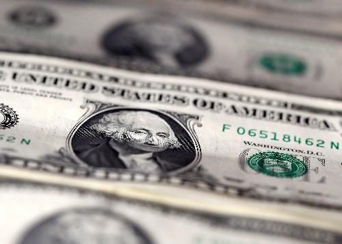 Dollar weaker on dovish Fed bets, sterling seesaws