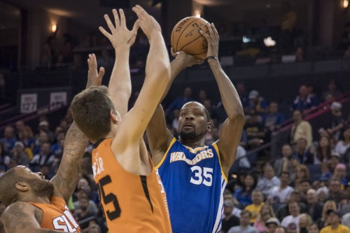 Thompson, Warriors shoot past Suns