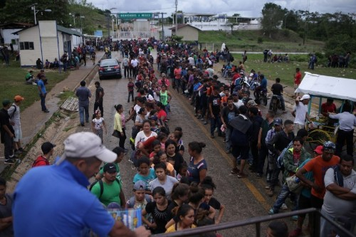 Brief scuffles at Guatemala-Mexico border as migrants try to cross