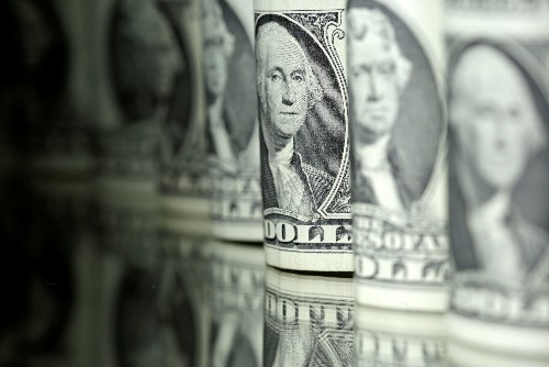 Dollar gains as Mexico tariffs averted, boosting risk sentiment