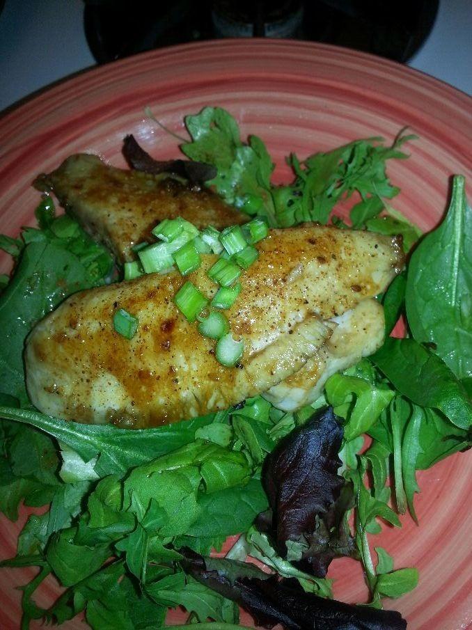 Pan seared tilapia w/ balsalmic vinegarette Italian marinate over a bed of mixed green salad