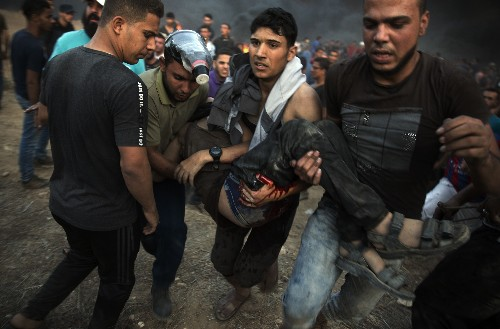 The Latest: Mourners hold funerals for 7 killed in Gaza