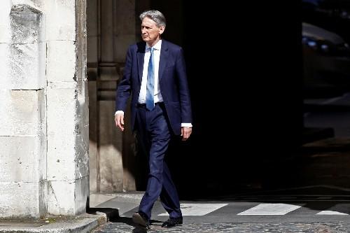 UK's Hammond attacks 'terrifying' views of Brexiteer Rees-Mogg