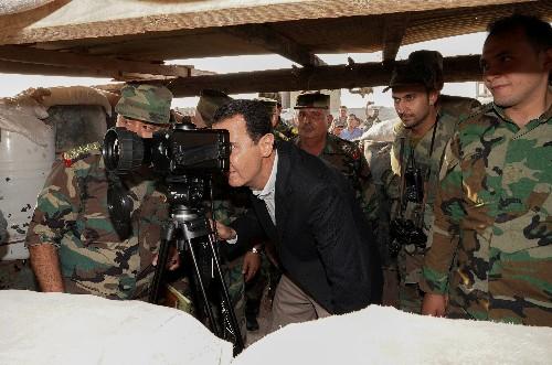 Calling Erdogan a 'thief', Syria's Assad tours Idlib frontline near rebels