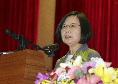 Taiwan leader touts island's determination to defend itself