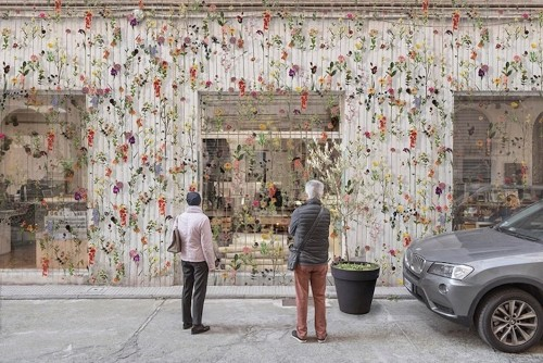 Colorful Curtain of Over 2,000 Flowers Cascades Down a Building's Façade