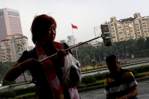 China to halt individual tourism permits for Taiwan amid rising tension