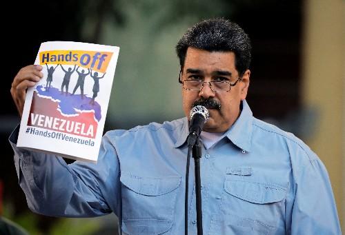 U.S. raises pressure on Maduro via sanctions, aid airlift