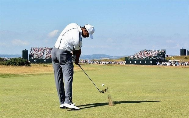 The Open 2014: Tiger Woods drive hits marshal in head