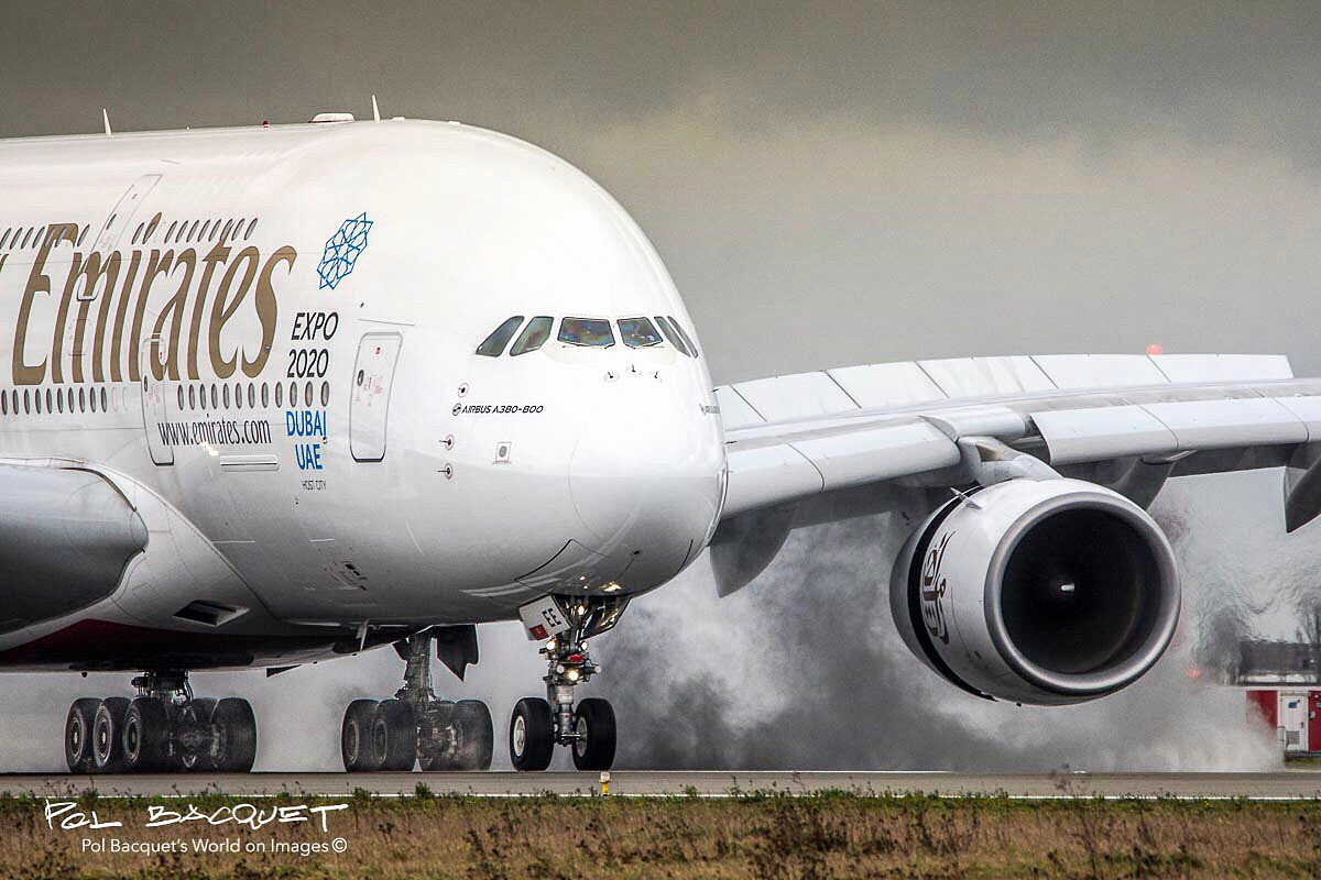 An Emirates Airbus A380 landing in Paris Roissy CDG Airport on a rainy day