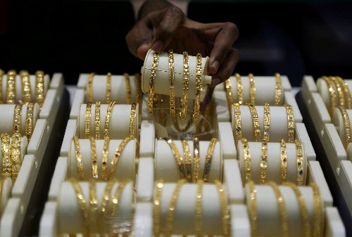 Gold holds above $1,600 on fears over economic impact of virus