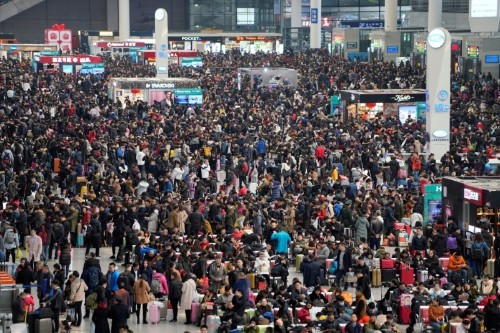 Virus casts shadow over China's biggest festival, but little worry at epicenter