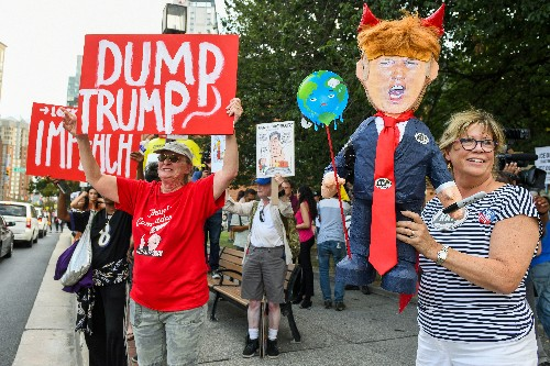 Protesters greet Trump in Baltimore after his tweets blasting city