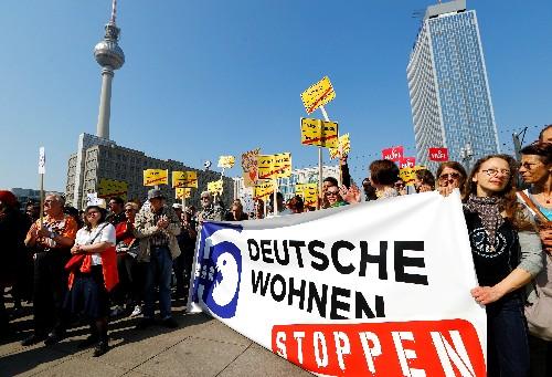 With rents spiraling, Merkel tells landlords: Serve the public