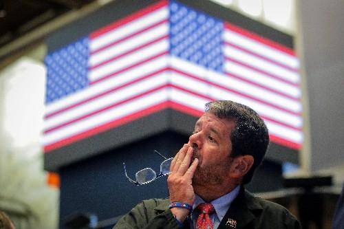 Borsa Usa, Wall Street scivola su calo yuan che riaccende timori su commercio