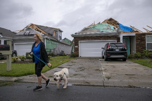 The Latest: Dorian churns north along North Carolina coast