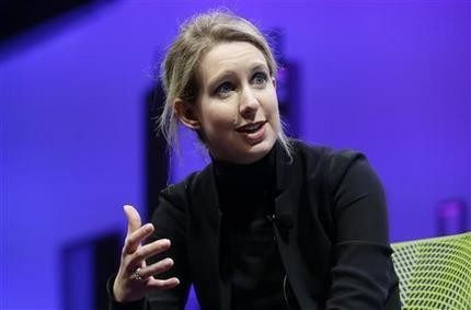Feds ban Theranos CEO Holmes from running lab for 2 years