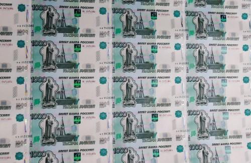 Рубль подрастает к уплате налогов и в ожидании параметров аукционов ОФЗ