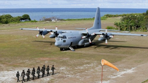 China, Philippines spar over military visit to island