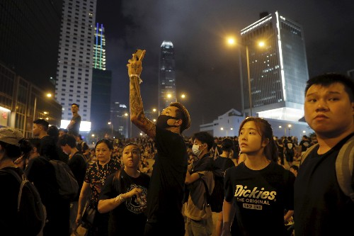 The Latest: Hong Kong police say want to clear protesters