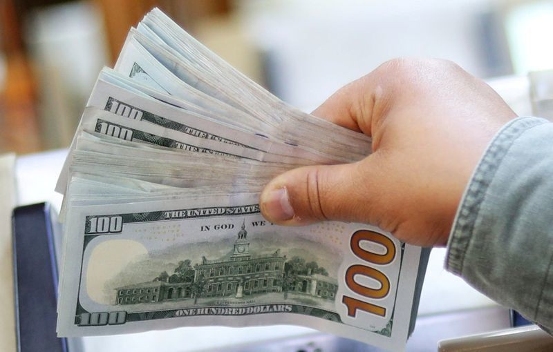 Dollar edges up after hitting 2-year low; jobs data in focus