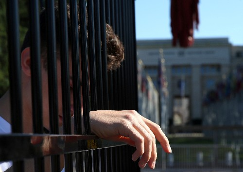 Teens stand in cage outside U.N. building to protest U.S. immigration policy