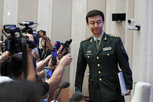 China says it won't rule out using force to reunify Taiwan