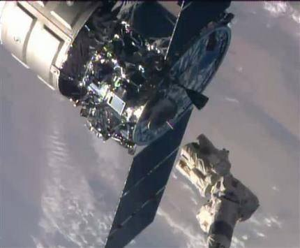 Space station supply ship exits, now packing trash
