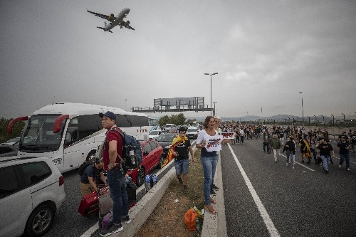 The Latest: 37 injured, 108 flights canceled in Barcelona