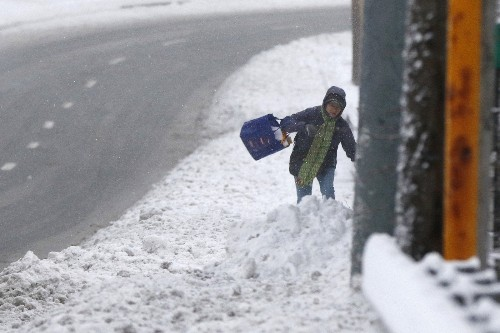Snowstorm Blasts Parts of US: Pictures