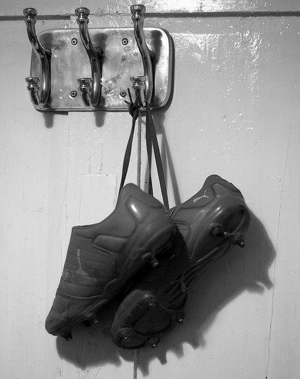 Hang up your boots: to permanently stop playing a sport. Ex: After a disastrous season it is rumoured that Gregory may hang up his boots once and for all.