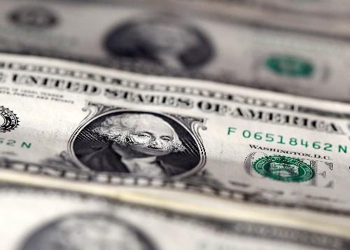 Dollar near three-week high after IMF cuts growth forecasts