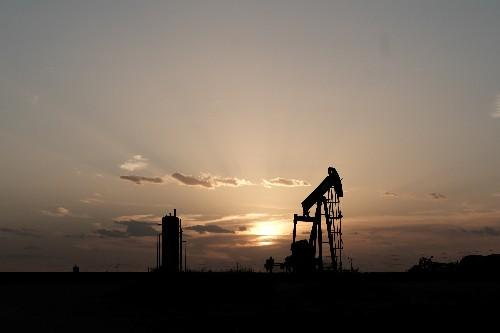 Oil drops on surprise U.S. crude build but tariff deadline eyed