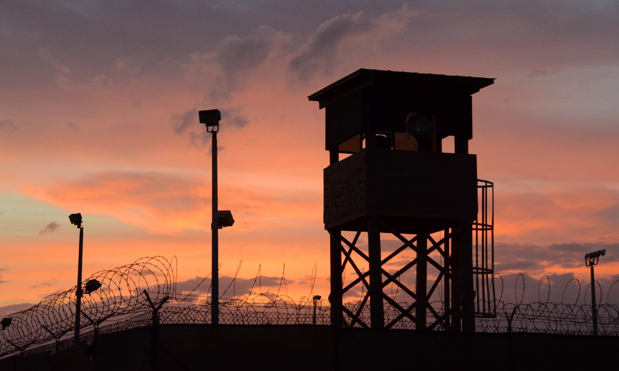 A tour of Guantánamo Bay: ghostlike figures wait as a promise goes unfulfilled