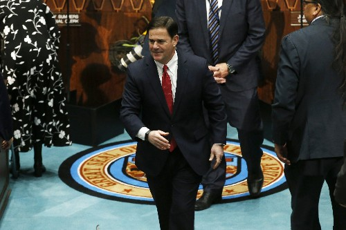 Arizona governor pulls immigration plan amid business revolt